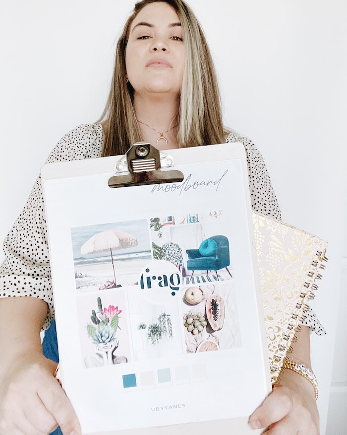 Woman holding a clipboard containing a moodboard